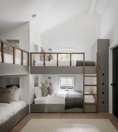 Bedroom Ideas - This modern bedroom has been furnished with custom-designed bunk beds. Each bunk bed has a built-in shelf at the head of the bed, and a minimalist wood ladder for easy access. Bunk Bed Rooms, Bunk Beds Built In, Best Bunk Beds, Build In Bunk Beds, Custom Bunk Beds, Cool Bunk Beds, Boys Bedroom Ideas With Bunk Beds, Built In Beds For Kids, Bunk Bed Rail