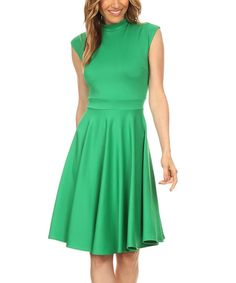 Dress for every occasion in this sleek dress boasting a sophisticated mock neckline and fit and flare silhouette.