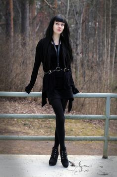 All black fall outfit w/ harness. And pretty hair.