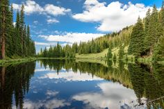 A calm day at Lake Irene provides a perfect reflection of the surrounding landscape. Wildlife Nature, Rocky Mountain National Park, Rocky Mountains, Nature Photography, Colorado, Waterfall, National Parks, Landscape, Travel