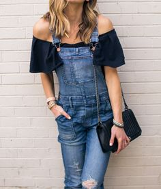 Obsessed with this street-savvy fall look, mixing a retro pair of overalls with an on-trend off the shoulder top!