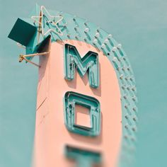 mid century motel sign in pink and aqua