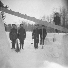 """Five of the Standart sailors helping the Imperial children building a snow fort at Tsarskoe Selo in 1916. """"AL"""""""
