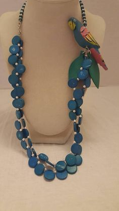 Check out this item in my Etsy shop https://www.etsy.com/listing/545677551/teal-blue-parrot-necklace-teal-blue