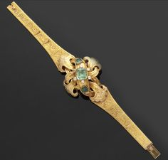 A mid 19th century gold mounted emerald and diamond set bracelet.