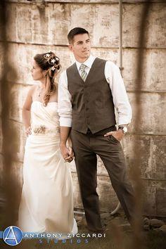 Jess & AJ posing for @AZiccardi during their photo shoot.  #barn #silo #rustic #wedding #barnwedding
