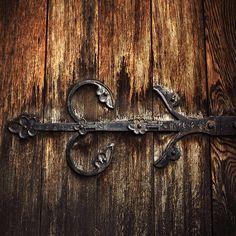 worn door with brass ornaments Door Knockers, Door Knobs, Medieval Door, Irish Catholic, Stamped Concrete, Doorway, Wood Doors, Wood Carving, Rustic