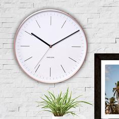 """<p><span style=""""font-size: medium;""""><strong>KARLSSON MINIMAL WHITE WALL CLOCK WITH COPPER CASE 27CM</strong></span></p> <p>To steal a line from Zoolander's Mugatu: that Karlsson Minimal Wall Clock's so hot right now. <br /><br />With its copp"""