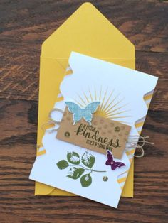 Hint:  I punched down both sides of my card front spacing evenly.  A piece of Moonlight Designer paper peeks around the punched edges.