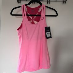 ASICS Fit Sana Contour Tank BRAND NEW With tags!!! Running tank with built in bra - great cut out design in the back. Never been worn. Excellent for running, yoga, training, etc. color: Pink asics Tops Tank Tops