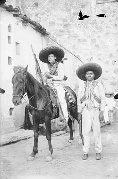 Two Revolutionists Wearing Sombreros, ca. 1910-1919, by Cruz Sanchez, held by DeGolyer Library. This photograph is from A collection of real photographic postcards, photographs, prints, original artwork, broadsides, currency, periodicals, books and manuscripts related to the Mexican Revolution. #Mexico #Revolution #Men #Soldiers #Firearms