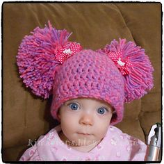 This hat is crocheted using two strands of yarn held together. It takes less than a skein of each color to complete the hat and the pompoms.