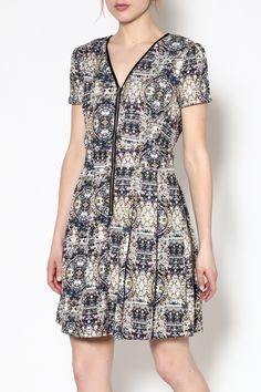 Casual short sleeve dress with glass window print detail and functional pockets. Zip-up front closure below the v-neckline. Pleated skirt.   Glass Window Dress by Angeleye London. Clothing - Dresses Chicago, Illinois