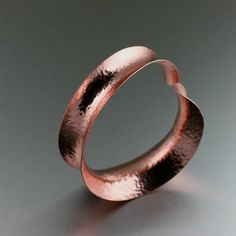 Trendy Hammered Copper Bangle Offered by https://www.ilovecopperjewelry.com/anticlastic-hammered-copper-bangle-bracelet.html #7thAnniversary #BoHo