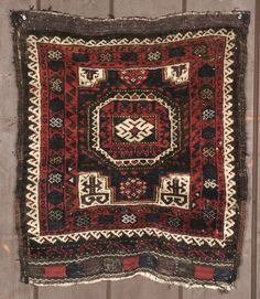 This is a Baluch bag face with a Turkman medallion.