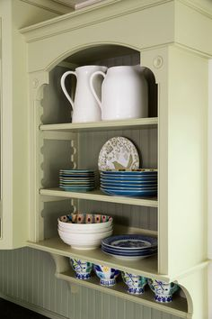 Detailed trim, including an old-fashioned shelf-height adjuster, warms up built-ins framing the kitchen sink.