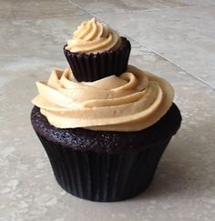 Chocolate cupcake with peanut butter Swiss meringue buttercream, topped with a frosted peanut butter cup.