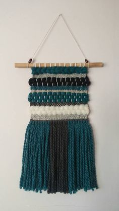 Check out this item in my Etsy shop https://www.etsy.com/listing/465905174/handwoven-wall-hangingtapestryhandloom