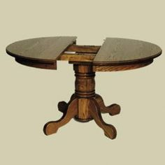Redux Antique Dining Tables - Heritage Colonial Round Single Pedestal Empire-Foot Extension Dining Table (Shown Partially Retracted). Includes 2 extension leaves. Available in premium Oak, Maple, & Cherry hardwoods and a full range of durable finishes. Find the Colonial Round Single Pedestal Empire-Foot Extension Dining Table at http://www.mennonite-furniture-studios.com/Amish-Heritage-Colonial-Round-Empire-Foot-Pedestal-Extension-Table-(2-Leaves)/