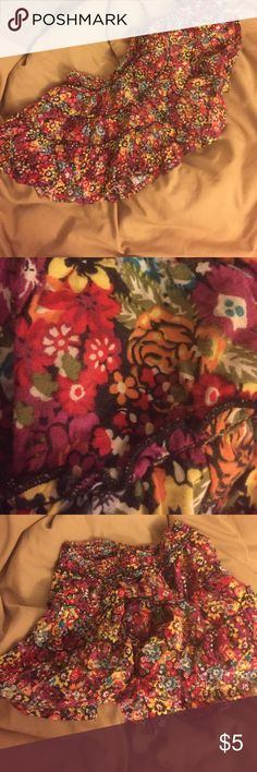 flouncy flowered skirt 4 fierce leggings/bare legs Medium. Machine wash. Tiered so that it has a great flounce and silhouette. Wonderful flowers. Would work with army boots. Leggings or bare skin Skirts Mini
