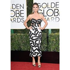 2bd6edb23c0 Television personality and model Heidi Klum dazzled in a beaded black and  white dress to attend the Annual Golden Globe Awards at The Beverly Hilton  Hotel.