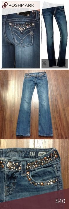 """Miss Me studded boot jeans In great used condition. Missing one hardware on the patch and one stud on the back of the waist. Please see photos. Other than that they look great with no holes or stains. Inseam is 33.5"""" long. Bundle with other items and save.                       d Miss Me Jeans Boot Cut"""