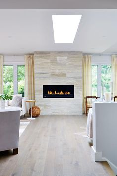 As seen on season 1 of Sarah Sees Potential, designer Sarah Richardson replaced an old, ugly fireplace with a chic, contemporary model and custom limestone tile surround. Dining Room Remodel, House Design, Dining Room Makeover, Family Room, Home, Fireplace Surrounds, Fireplace Design, Room Remodeling, Modern Fireplace