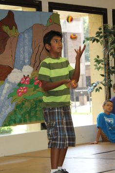 Camper in a juggling class.