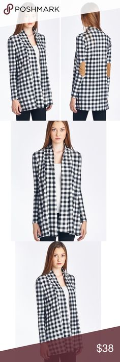Navy & White Checker Cardigan & Suede Patch Elbows Navy Blue & White Checker Open Front Cardigan with Suede Patch Elbows. No Trades. Price is Firm Unless Bundled.  MADE IN USA . Polyester & Spandex Blend. No Trades. Price is Firm Unless Bundled. Made in USA GlamVault Sweaters Cardigans