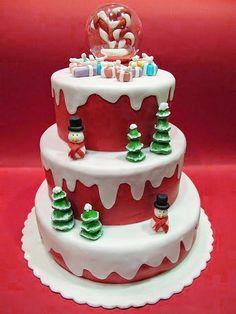 Bolos de Natal com temas da época: floco de neve, Papai Noel, boneco de neve, guirlanda, árvore de Natal, trenó e rena.