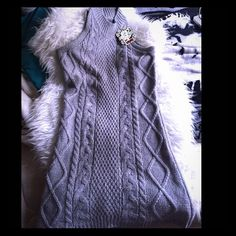 Sz.M BNWT Silver Sweater dress Brand new with tags pretty and warm Sz.M BNWT Silver Sweater dress. This dress has sparkles all through out it intertwined in the warm woven silver sweater dress. Sweet. Silver gray color. Dresses