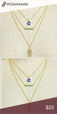 """Jewelry   Multi Layer Hamsa Evil Eye Necklace NWT brand new in original packaging // triple layer chain gold-plated necklace // blue evil eye stone, golden bar, & filigree Hamsa Palm / Hand of Fatima turquoise stone in center // 9.5"""" + extender for adjustable length // *Nickel & Lead free* // -Also available in silver, see separate listing . Bundle & save! Jewelry Necklaces"""