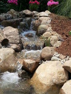 Waterfall created by Living Water Landscape Service in Battle Creek, MI. #WaterfallWednesday