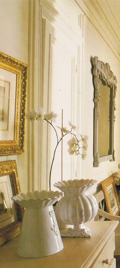 """Astier white with cream, gilded frames, and """"dove French gray"""" paint on hall mirror, chest and bench"""