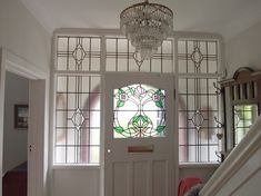 Through The Round Window: Stained Glass Door Panel with Contemporary Twist Stained Glass Door, Home, 1930s House, Contemporary Front Doors, House, Glass Doors Interior, Sliding Glass Door, Glass Door, House Front