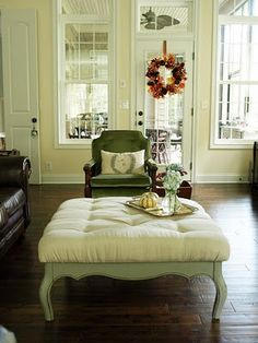 I love this tufted ottoman. Don't know if I'd have the patience to recreate it though.