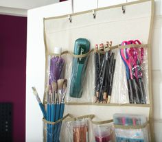 An over-the-door shoe organizer is perfect for storing craft supplies!