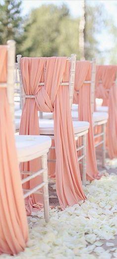 coral beach wedding chair cover / http://www.himisspuff.com/wedding-chair-decor-ideas/