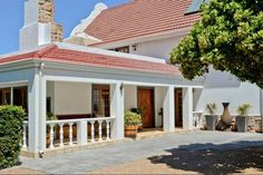 Woodlands Guest House in Somerset West has three guest rooms of which one offers a self-catering option. Somerset West, Cape Dutch, Guest Rooms, Cabo, 1930s, Places, Catering, Outdoor Decor, House