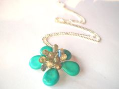 Turquoise flower necklace wire wrapped with by StarJewels on Etsy, $44.00