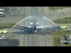 Trump Plane Given Water Cannon Salute - YouTube  Actually, it's two firetrucks peeing on Trump's plane.