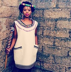 Lusanda Kori gives traditional Xhosa attire a very modern and street style twist. View all her amazing, vibrant looks here. Xhosa Attire, African Attire, African Wear, African Fashion Dresses, African Women, African Dress, Traditional Dresses Designs, African Traditional Dresses, Traditional Outfits