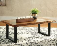 """Ashley Furniture Brosward Coffee Table with Made of acacia wood and engineered wood,Two-tone finish; natural wood finish top on a black frame,Faux """"live"""" edge top on 2 sides for a natural look Coffee Table Images, Coffe Table, Ashley Furniture Outlet, Ashley Home, Urban Loft, Live Edge Wood, Natural Wood Finish, At Home Store, Engineered Wood"""