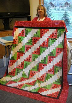 Watermelon quilt, Log Cabin. I am always amazed at the multitude of effects a quilter can creat with this block! This is very pretty!