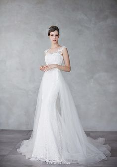 The perfect marriage of classic and contemporary, this sophisticated white gown from Ray & Co. evokes head-turning elegance!