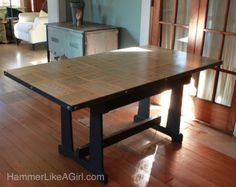 Recycling an old table and top with dictionary pages