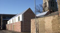 Mews housing development, listed stone, brick and render all with internal courtyards by RAW architecture