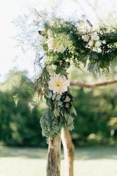 Rustic floral wedding arbor: http://www.stylemepretty.com/pennsylvania-weddings/2015/11/27/elegant-outdoor-fall-wedding-with-an-apple-orchard-ceremony/ | Photography: Emily Wren - http://emilywrenweddings.com/