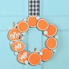 It's fall y'all! And it's time to get your crafty on and make this wood slice pumpkin wreath.  #doordecor #homedecordiy #halloweendecor #falldecordiy #fun365 #orientaltrading