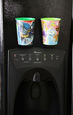 Add magnets to plastic cups and place on fridge so kids can easily get water and always know where cup is